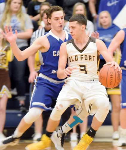 PHOTO BY JILL GOSCHE  Old Fort's AJ Baker controls the ball against the defense of Calvert's Peyton Deats during the game at Lakota Friday.