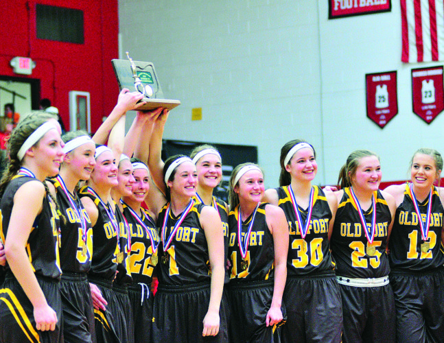 PHOTO BYPATGAIETTO Members of the Old Fort girls basketball team celebrate with the district trophy after beating Arcadia in Fostoria Saturday.