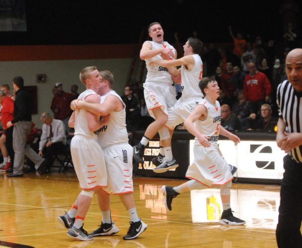 PHOTO BY JONATHON BIRD Upper Sandusky players run onto the court following their victory over Wapakoneta during a district basketball game at Ohio Northern University Wednesday.
