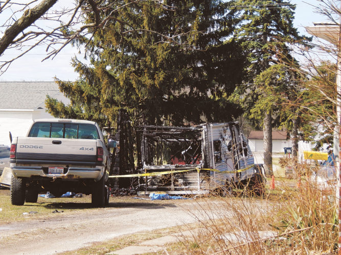 PHOTO BY SETH WEBER This camper and garage burned down in Attica early Sunday morning. Attica-Venice-Reed EMS and Fire District assisted with a house fire in the 6000 block of SR 4 before this fire at 10:12 p.m. and again when it rekindled at 7:57 a.m. Sunday.