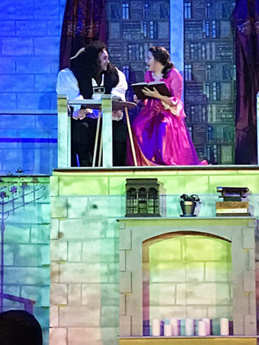 """PHOTO SUBMITTED Seniors Hannah Whitman (right) as Belle and Dylan Noon as Beast rehearse for Old Fort High School's production of Disney's """"The Beauty and The Beast: The Broadway Musical."""" Production dates are Friday and Saturday."""