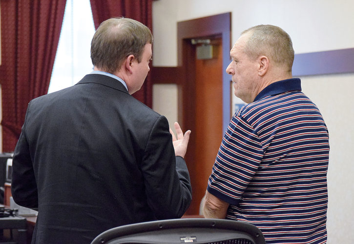 PHOTO BY JILL GOSCHE David A. Yates (right) listens to his attorney, Alex Smith, after Yates was acquitted by a jury of a theft charge during a trial in Seneca County Common Pleas Court Judge Michael Kelbley's courtroom Monday.
