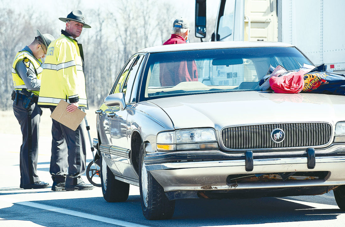 PHOTO BY JILL GOSCHE State Highway Patrol personnel work at the scene of an accident on SR 12 Tuesday morning.