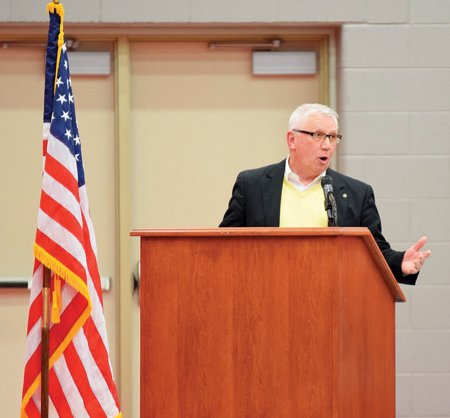 PHOTO BY JILL GOSCHE Lee Martin, who is retired from Heidelberg University, addresses National Machinery Citizenship Award winners at Hopewell-Loudon High School Monday evening. To view more photos from this event, visit cu.advertiser-tribune.com.
