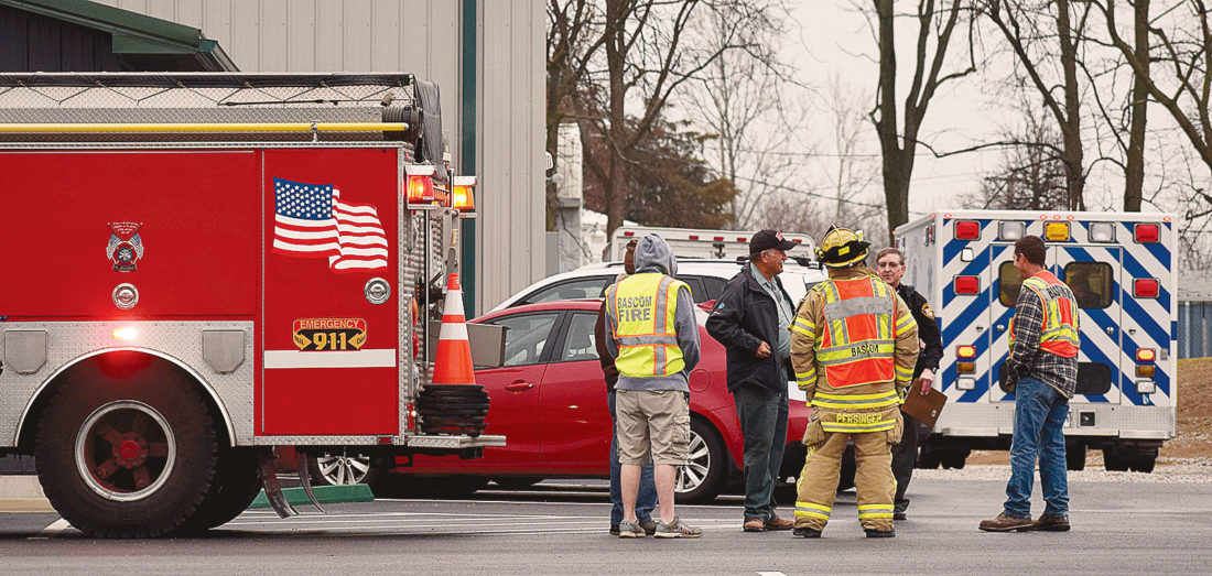 PHOTO BY JILL GOSCHE Rescue personnel work at the scene of an accident at Tiffin Deluxe Services, 1601 TR 1186, Tuesday morning.