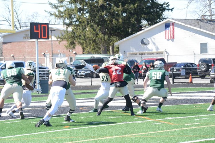 PHOTO COURTESYOFTHE TIFFINUNIVERSITY SPORTSINFORMATIONDEPARTMENT Tiffin University quarterback Jihad Vercher (12) launches a pass for the Green team Saturday at Tiffin University's spring game at Frost-Kalnow Stadium.
