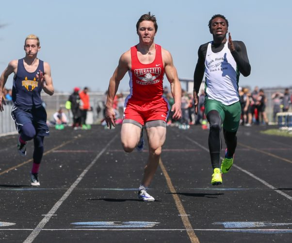 PHOTOBYSTEVEWILLIAMS At left, Hopewell-Loudon's Sam Stickley (center) runs by the competition in the 100 at the Lakota Invitational in Kansas.