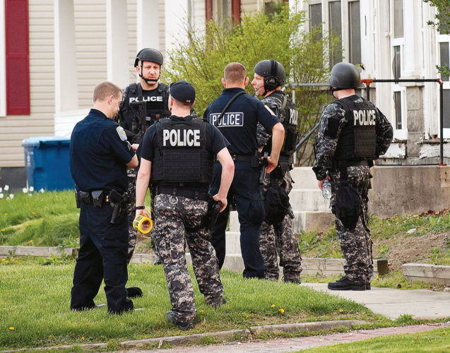 PHOTO BY JILL GOSCHE Tiffin Police Department  officers work at the scene of a standoff at 97 Jackson St. Saturday evening.