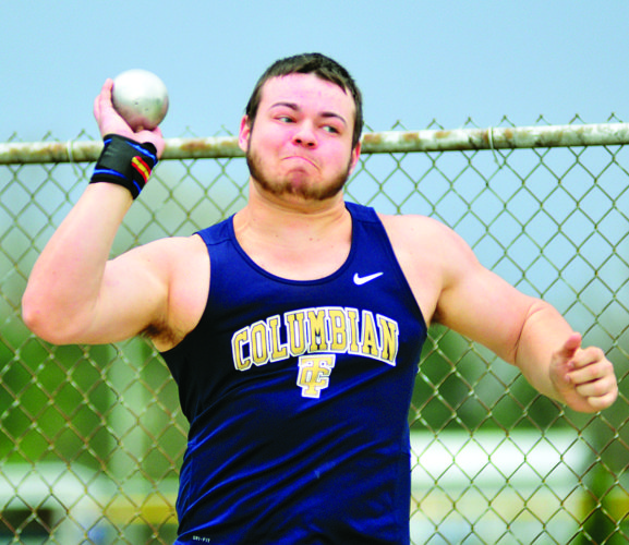 PHOTOS BY PAT GAIETTO Columbian's Drake DeVore throws the shot put 46 feet at the A.W. Hendricks Invitational in Clyde Saturday.