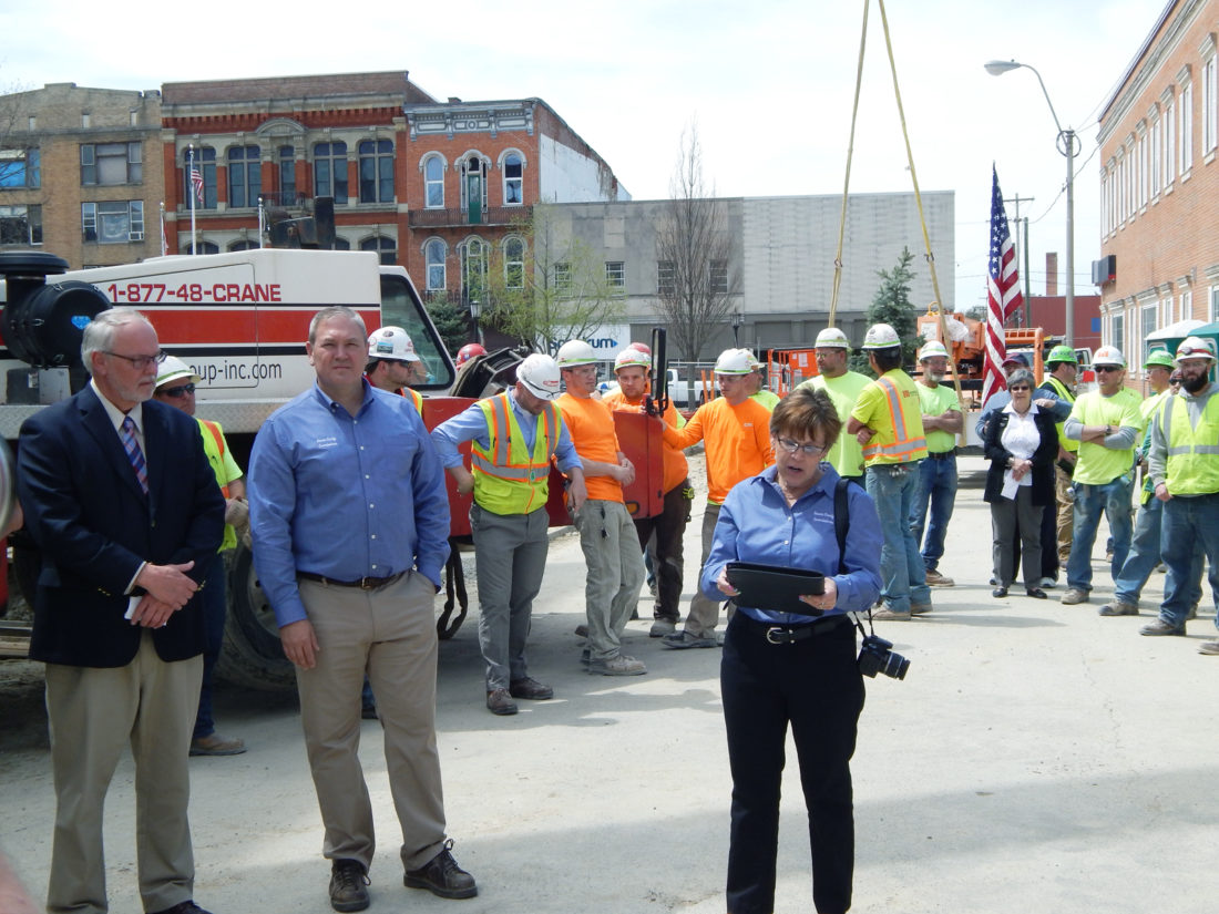 PHOTO BY JIMMY FLINT Seneca County Common Pleas Court Judge Michael Kelbley (from left) and Commissioner Shayne Thomas look on as Commissioner Holly Stacy delivers remarks during the topping-out ceremony for the joint justice center Tuesday afternoon.