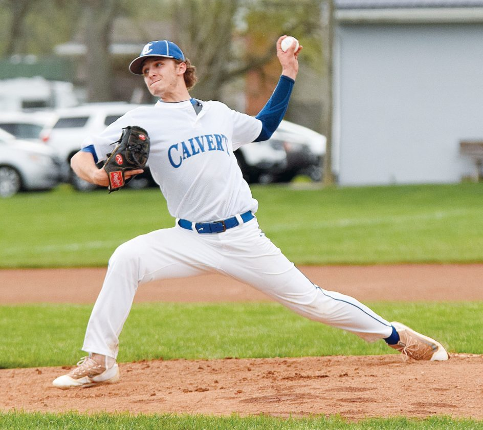 PHOTO BY JILL GOSCHE Calvert's Peyton Deats pitches during the game against New Riegel in Tiffin Thursday.