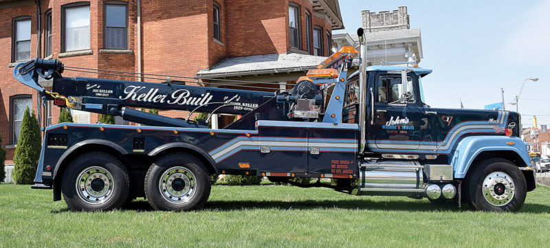 PHOTO BY JILL GOSCHE A Mack truck, the first truck that started the towing portion of John's Welding and Towing, is parked in a grassy lot near Hoffman-Gottfried-Mack Funeral Home and Crematory Wednesday afternoon.