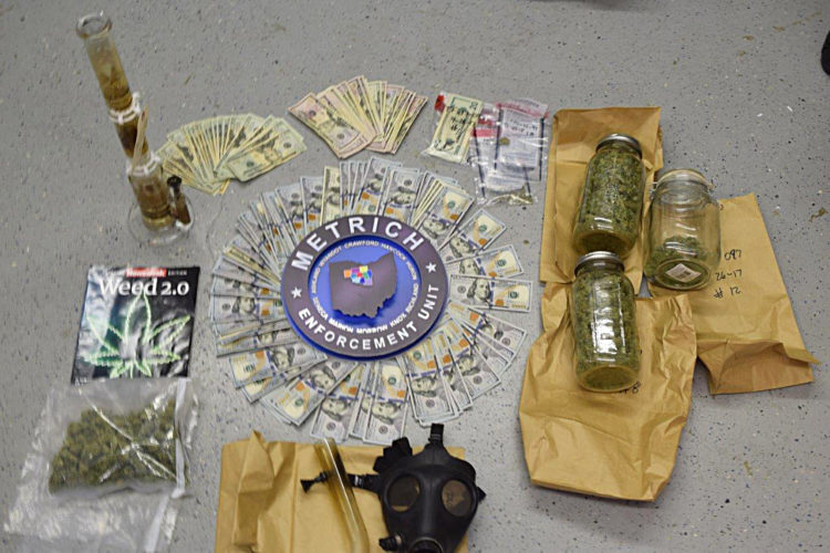 PHOTO SUBMITTED Police seized marijuana, about $10,000 in U.S. currency, drug paraphernalia and criminal tools during execution of a drug-related search warrant in the 100 block of Frost Parkway Wednesday morning.