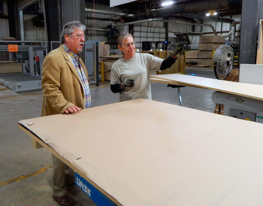 PHOTO BY JIMMY FLINT Laminate Technologies CEO Fred Zoeller speaks with an employee of the company during a tour.