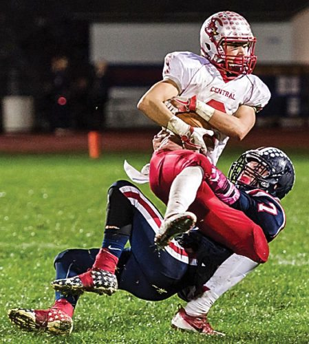 Photo for the Mirror by Jim Baker Huntingdon's Jairus Werner takes down Central's Noah Muthler during Friday night's game in Huntingdon.