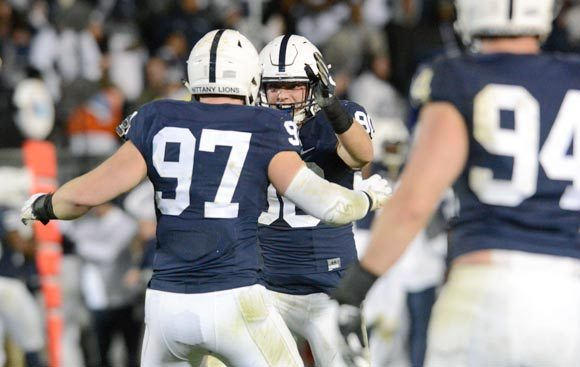 Mirror photo by Patrick Waksmunski / Penn State defensive end Garrett Sickels (90) and defensive end Ryan Buchholz (97) celebrate stopping Ohio State on a 4th and 23 at OSU's 29 to end the game at Beaver Stadium on Saturday.