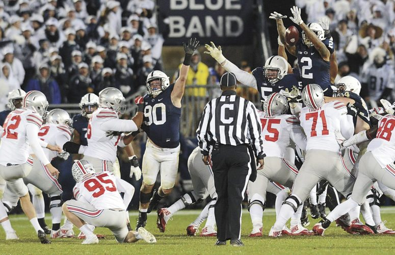 Mirror photo by Patrick Waksmunski Penn State's Marcus Allen (2) blocks an attempted field goal by Ohio State's Tyler Durbin late in the fourth quarter on Saturday night at Beaver Stadium.