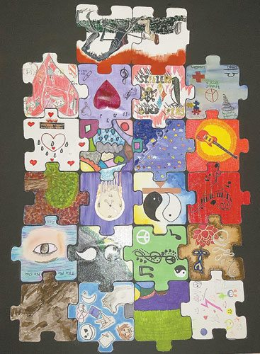 "Courtesy photo An artist from the Home Nursing Agency art therapy program shares a closer look at this unique piece of artwork titled ""My Life as a Puzzle"" to be on display at The Creative Healing Gallery art exhibit on Tuesday."