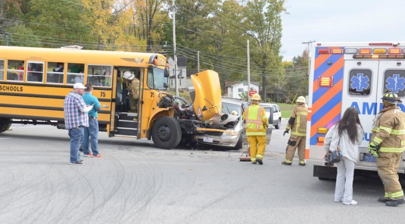 Mirror photo by Gary M. Baranec / Emergency personnel check on the condition of children returning home inside an Altoona Area School District bus that collided with a van on Park Avenue on Wednesday afternoon.