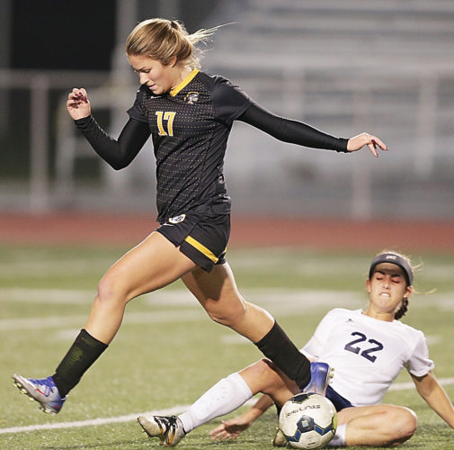 HollidaysburgvsMontour _3Gsoc  HHS 22 makes a sliding steal from    MHS (L) 17  Alex Faith  Hollidaysburg vs  Montour  Girls 3A PIAA soccer playoffs  11-8-16 Photo for the Mirror  Ed Lee