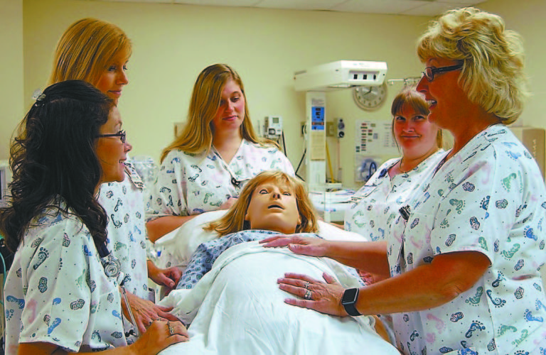 Courtesy photo Shown with Noelle, Conemaugh Health System's birthing simulator, are (from left): Autumn Claycomb, Rebecca Wertz, Rachel Holmes, Sue Turner and Sharon Hanlon, all registered nurses at Nason Hospital, Roaring Spring.