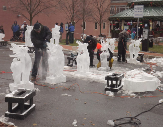 Mirror photo by Sean Sauro / A group of sculptors makes ice statues during the Dickens of a Christmas celebration in Ebensburg on Saturday. Hundreds of people walked the streets, wearing warm coats and hats to combat frigid air.