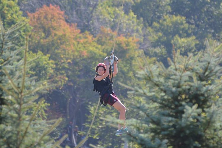 Photo by Cherie Hicks Genevieve Timm of Hollidaysburg zips along Seven Springs Resort's Laurel Ridgeline Zipline Tour. The gift of tickets to an outdoor experience, a sporting event or concert are just a few ideas for holiday giving.