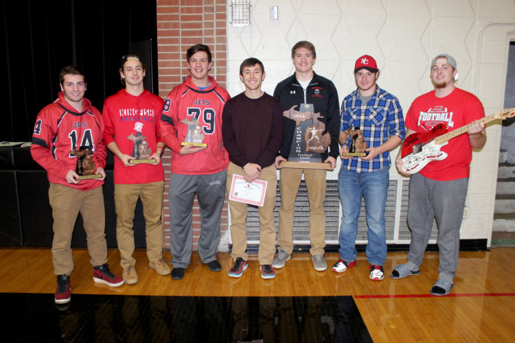 Dennis Grall | Daily Press The North Central High School Fall Sports Banquet was held Wednesday night and this group received All-State and All-U.P. awards. From left, they are Tyler Bentley, Bobby Kleiman, Taylor Belongie of football, cross country Seth Polfus and football honorees Jason Whitens, Tanner Poupore and Ryan Plunger. Whitens and Kleiman were eight-player all-state and Whitens was the division's player of the year for the second straight time as North Central repeated as state champion. Plunger is holding a Neville guitar donated to the school and football team by Jeff and Danielle Neville of Hermansville, who make guitars for many Nashville performers. Bentley will play football at Alma College.