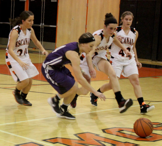 Dennis Grall | Daily Press Jordan Miller of Marinette chases a loose ball toward her team bench Thursday along with Escanaba defenders Maddy Willis (center) and Lexi Chaillier (42). Also in pursuit is Savannah Barron (24). Escanaba won 69-38.