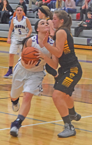 Gladstone's Taylor Hunter drives to the basket on Gwinn's Brenna Bruce in Friday's game. Hunter scored 21 points and grabbed nine rebounds in the Braves 54-32 win.