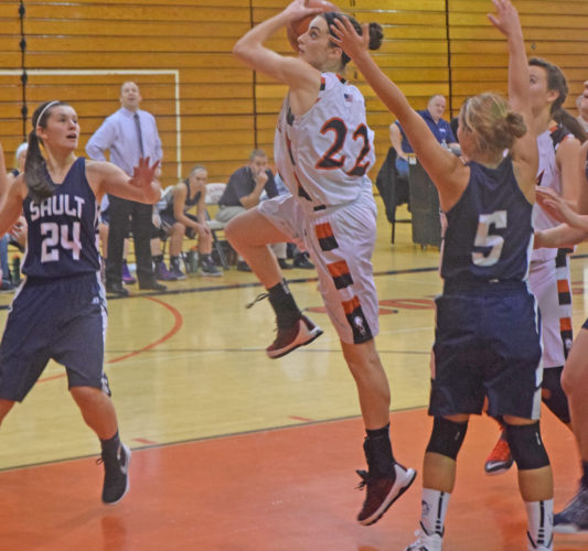 Mike Mattson | Daily Press Escanaba's Maddy Willis drives to the basket as Sault Ste. Marie players Ashtyn Bell (24) and Mackenzie Kalchik (5) defend in Saturday's game. The Blue Devils defeated Esky 43-29.