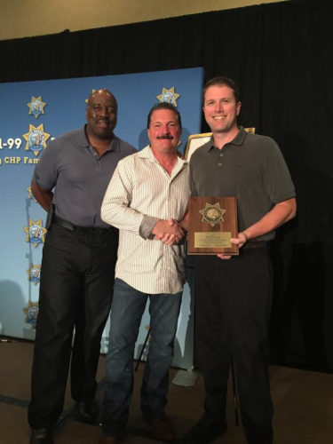 Courtesy photo Brad Houle, far right, received the prestigious award of the CHP 11-99 Commissioner's Award for his generous support of a foundation that supports CHP employees and their families who are facing hardships.
