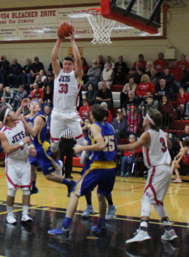 Avery Bundgaard | Daily Press North Central's Jason Whitens (30) skies for the offensive rebound over Stenphenson's Ethan Brown during Monday's game. Whitens led both teams with 25 points.