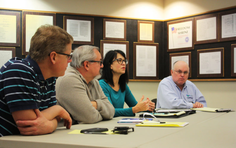 Jenny Lancour | Daily Press Dotty LaJoye, director of the Central Upper Peninsula Planning and Development (CUPPAD) Regional Commission discusses ways to attract people to visit, live and invest in Escanaba during a marketing work session at city hall Tuesday. Pictured, from left, are Public Works employee Keith Marenger, City Clerk Bob Richards, LaJoye, and Richard Smith, also of CUPPAD.