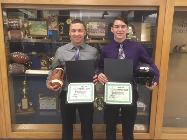 Courtesy photo Gladstone's Owen Hanson, left, and Alex Chouinard recently received their All-U.P. football certificates. Chouinard made the Large School squad as a linebacker and Hanson was a specialist on the Large School offense.