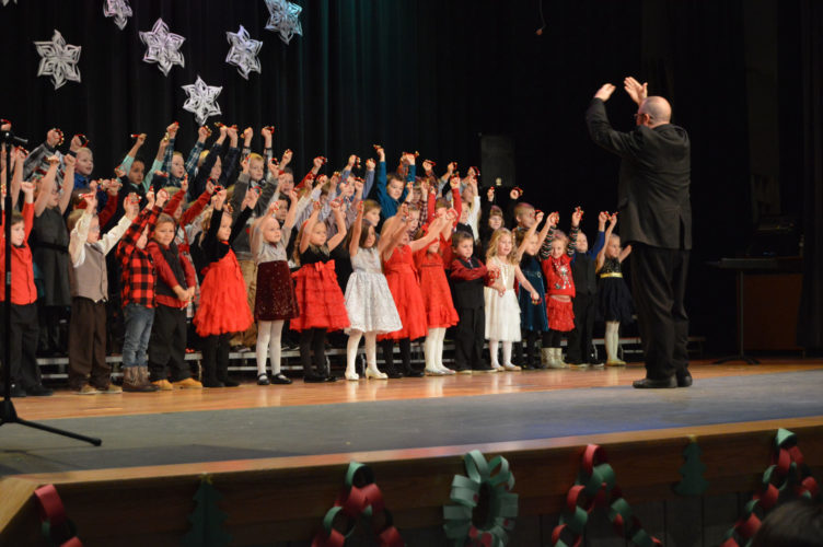 "The Readiness Kindergarten classes of W.C. Cameron Elementary School perform ""Jingle Bells"" during their holiday program Thursday afternoon in the Gladstone High School auditorium. Today, Cameron Elementary kindergarten and second grade will perform at 1 p.m. in the high school auditorium. Schools around the area will continue to perform their holiday programs going into next week as Christmas break for the students approaches."