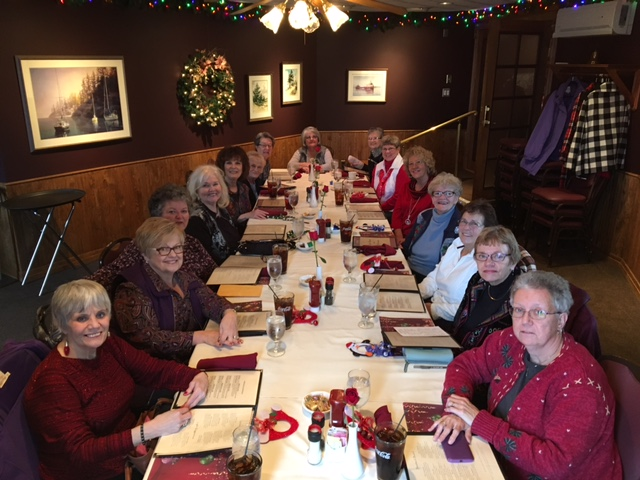 Courtesy photo Fifteen ladies, all graduates of Escanaba class of '66, are pictured at their holiday luncheon. Each year, they donate cases of personal hygiene supplies for women to the St. Vincent de Paul Food Bank.