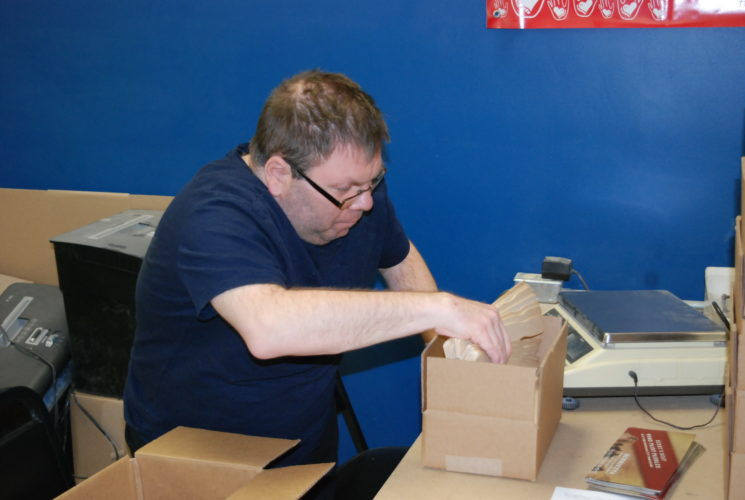 Jordan Beck | Daily Press Lakestate Industries employee Dennis Diener does packaging work Thursday. Lakestate's annual endowment fund campaign is beginning today with the inclusion of envelopes in today's issue of the Daily Press.