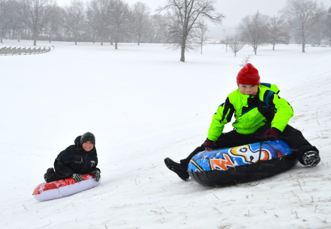 Haley Gustafson | Daily Press Bark River-Harris School student Lance Guenette, left, and his friend Braden Cooper, a Holy Name Catholic School student, spend their snow day Tuesday afternoon tubing at the sledding hill at Ludington Park. Due to harsh weather conditions Tuesday, many of the area schools were canceled allowing a day of play for kids.