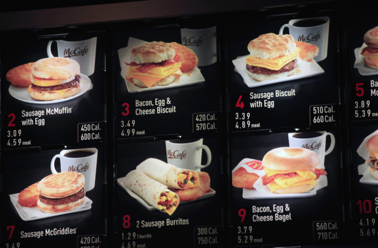 AP Photo/Mark Lennihan, File In this Sept. 12, 2012 file photo, items on the breakfast menu, including the calories, are posted at a McDonald's restaurant in New York. Restaurant and grocery chains scrambling to post calorie counts on their menus by spring have been peppering the Food and Drug Administration with queries that offer a window, often complex, occasionally comic, into the ingredient riddles they are trying to solve.