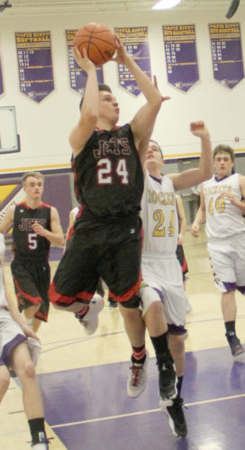 Avery Bundgaard | Daily Press North Central's Austin Poupore (24) goes up for a layup against Rapid River's Levi Miller Monday at Rapid River.