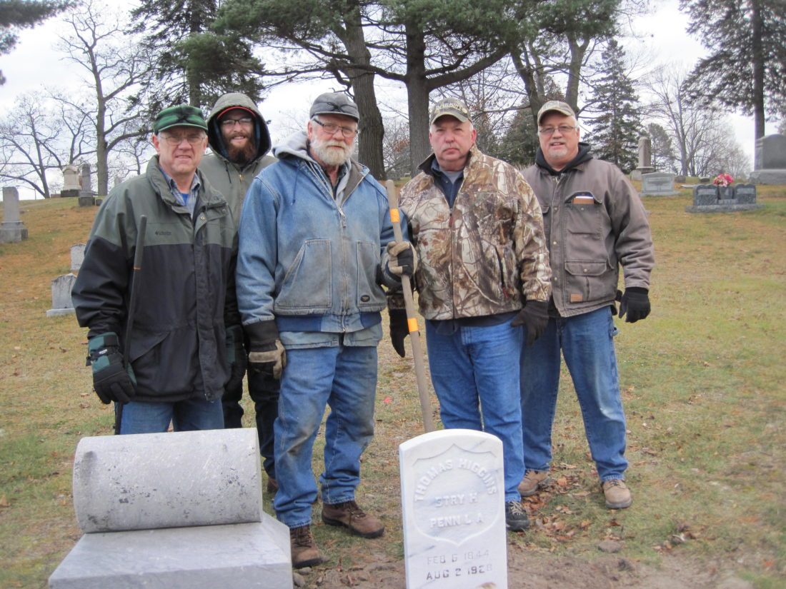 Courtesy photo Volunteers who have been working to replace gravestones for Civil War veterans pause for a photo at Lakeview Cemetary in Escanaba. The graves of some Civil War veterans at the cemetary were unmarked or were marked with stones that were too weathered to be readable. Stones for three more unmarked graves are planned and the cemetary intends to have a dedication ceremony in the spring.