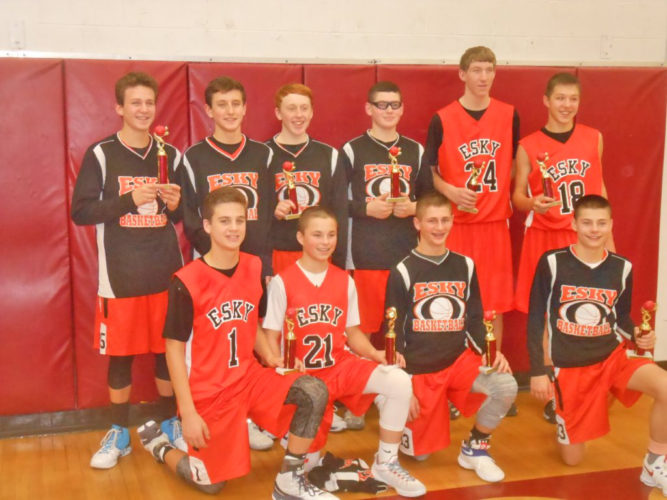 Courtesy photo The Escanaba boys eighth grade travel basketball team defeated Gladstone 64-35 Saturday to win the Menominee Hoops Club Tournament. Team members are bottom row from left, Brandon Frazer, Tyler Lawson, Curtis Kuchenberg and Chris Platt. Top row from left, Anthony Seymour, Nathan Lord, Riley Lamb, Brett Schlenvogt, Carter Hudson and Bryant Maki.