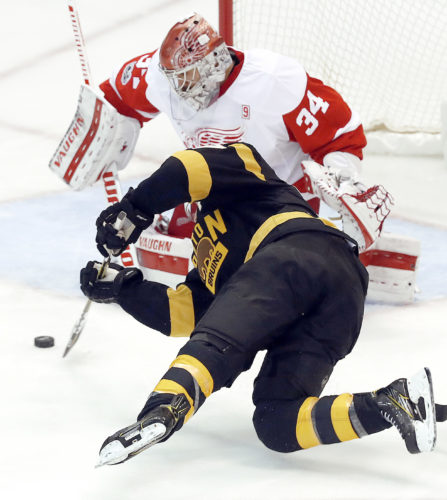 AP photo Detroit Red Wings goalie Petr Mrazek (34) stops a shot by Boston Bruins center Patrice Bergeron (37) in the third period Wednesday in Detroit.
