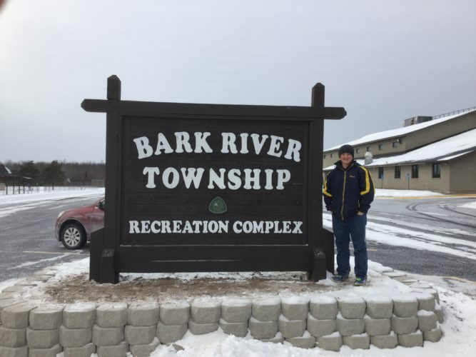Courtesy photos Local Boy Scout Brad Vandermissen stands next to the Bark River Township Recreation Complex sign, located outside of the Bark River Senior Center, after re-doing the landscaping around the sign in order to earn his Eagle Scout badge earlier this year.