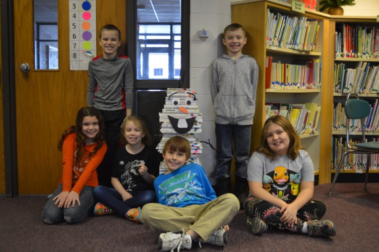 Haley Gustafson | Daily Press Third-graders, Hayden Moulds, Jared Huskey, Lily Germain, Olivia Johnson, Dylan Poitevinte, and Chloe Anderson are shown with Olaf that is made out of books at the library at Webster Elementary School.