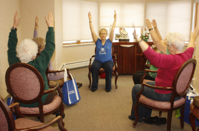 "Jenny Lancour | Daily Press Participants take part in a yoga session with Bobbi Silverstone, of Serenity Yoga and Breathwork, during ""A New Year, A New You"" Senior Health Fair held Friday at North Woods Place Senior Living in Escanaba. Two dozen businesses and agencies provided information and demonstrations on a variety of health- and senior-related topics for North Woods residents and visitors."