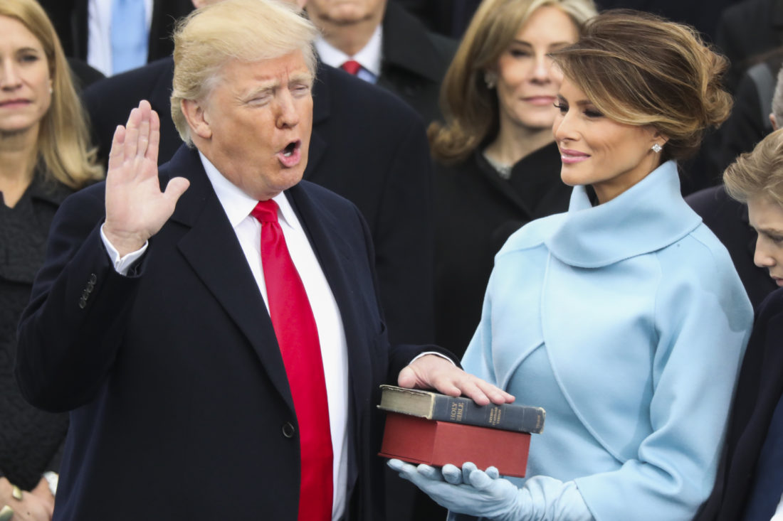 Donald Trump is sworn in as the 45th president of the United States as Melania Trump looks on during the 58th Presidential Inauguration at the U.S. Capitol in Washington, Friday, Jan. 20, 2017. (AP Photo/Andrew Harnik)