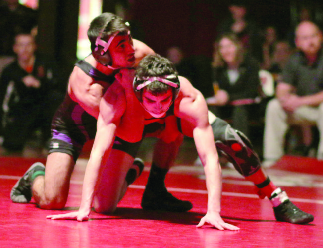 Munising's Zach McGowan, right, grapples with Gladstone's Vadym Torvinen at the U.P. Wrestling Championships Saturday, Jan. 21, 2017, at Marquette Senior High School. (Journal photo by Rachel Oakley)