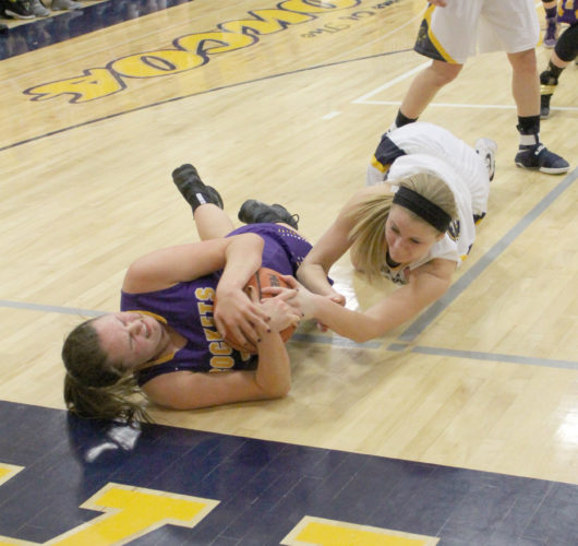 Avery Bundgaard | Daily Press Rapid River's Shelby LaCosse and Bark River-Harris' Josie Greenfield scramble for a loose ball in Monday night's game.